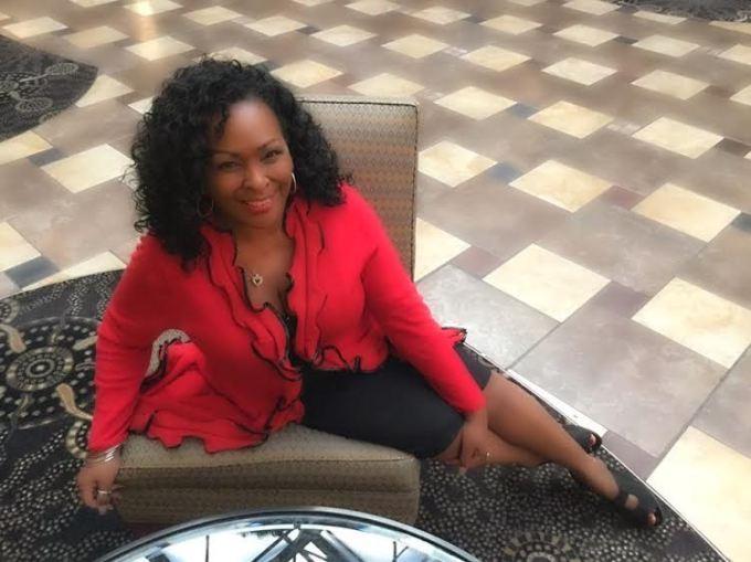 red jacket on lounge Jewel Diamond Taylor